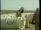 Attack on Iraq begins LTN special LIB Inspectors in protective clothing and gas masks examining scud missiles GVs Missiles Soldier operating patriot...