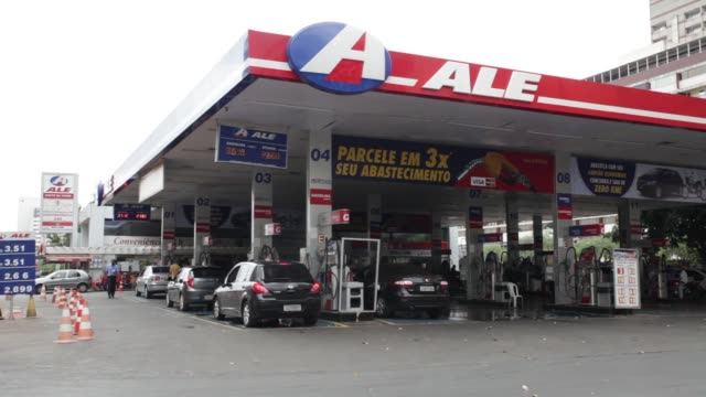 Attendants help customers at the Posto da Torre or Tower Gas Station in Brasilia Brazil on Tuesday Sept 8 2015 Authorities have been conducting a...