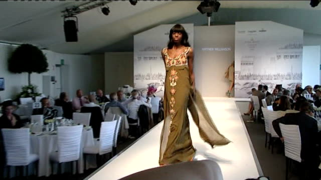 Attendees at Royal Ascot Unidentified female models model clothes on catwalk