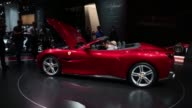 Attendees inspect the interior of a Ferrari NV Portofino entrylevel supercar during the first media preview day of the IAA Frankfurt Motor Show in...