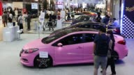 Attendees look at customized vehicles at the Seoul Auto Salon 2013 in Seoul South Korea on Thursday July 11 General views cars exhibited at the Seoul...