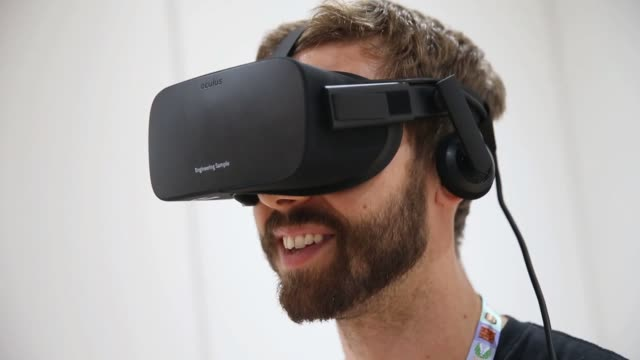 Attendees play a game on an Oculus Rift virtual reality headset during the E3 Electronic Entertainment Expo in Los Angeles California US on Tuesday...