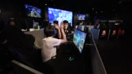 Attendees play Activision Blizzard Inc's Overwatch computer game at the AOC Open eSports event in Tokyo Japan on Saturday July 1 2017