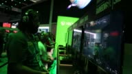 Attendees play Microsoft Corp Xbox One games during the E3 Electronic Entertainment Expo in Los Angeles California US on Wednesday June 17 2015 Shots...