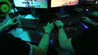 Attendees wear headsets as they play computer games using Microsoft Corps Windows 10 operating system at the Gamescom video games trade fair in...