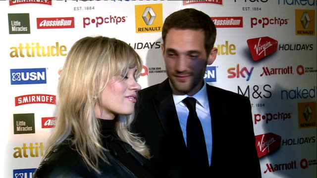 Arrivals ENGLAND London INT GV's of red carpet interview including Former Pussycat Doll member and television personality Kimberly Wyatt and husband...