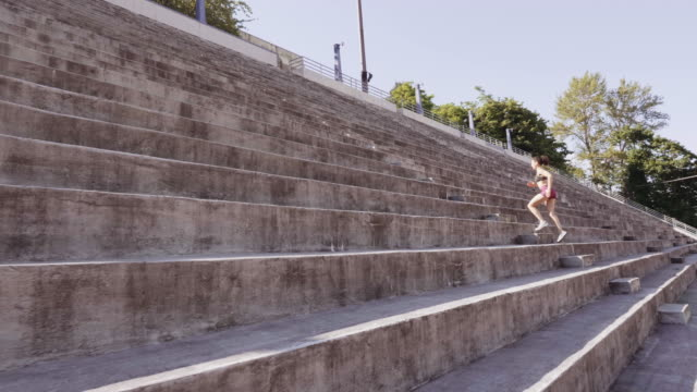 UHD 4K: Attractive adult female training and sprinting up stairs