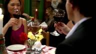 Attractive Couple Toast in Italian Restaurant