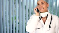 Attractive female surgeon on the phone