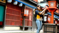 Attractive Japanese woman taking photos with smartphone on tourist location