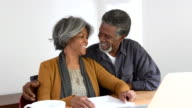 Attractive senior African American couple laughing and smiling