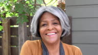Attractive senior African American woman smiling to camera