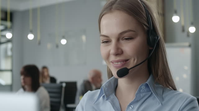Attractive young call center agent