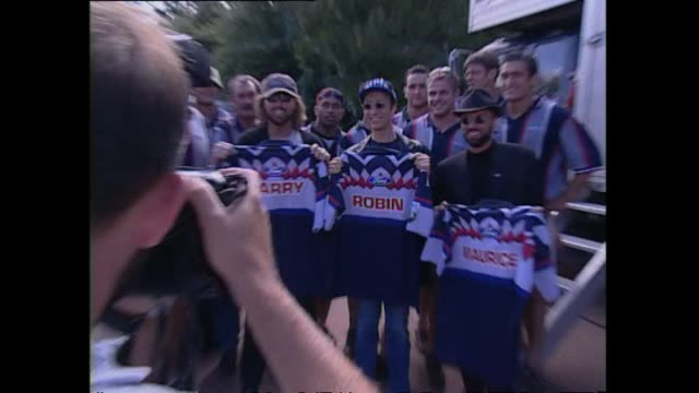 Auckland Blues Super 12 rugby team captain Robin Brooke presenting pop superstars Bee Gees with personalised rugby jerseys