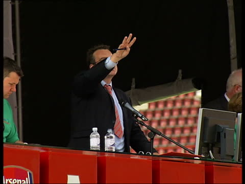 Auction of Arsenal FC memorabilia at Highbury Stadium ENGLAND London Highbury Arsenal Stadium EXT Auctioneer taking bids standing on temporary stage...
