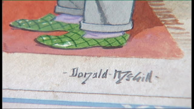 Auction of saucy postcards Tennants Auctioneers INT Close Shot Detail of signature on postcard Donald McGill Watercolour cartoon artworks on display
