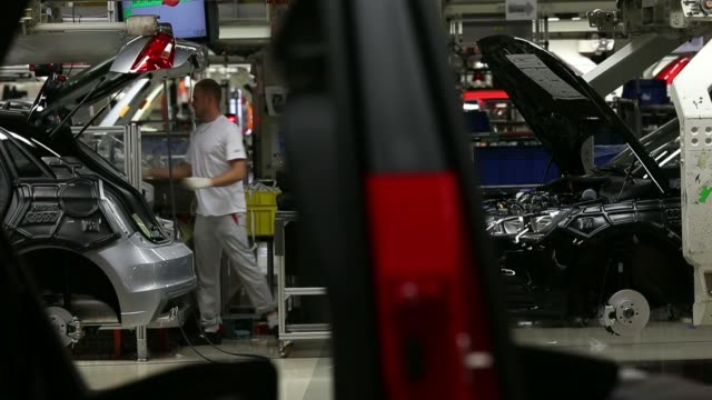 Audi A1 automobiles move along the production line during manufacture at the Audi AG factory in Vorst Belgium on Tuesday June 17 Employees fit...