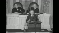 [Audio speed issues throughout] Two shots of Pres Harry S Truman on speaker's platform giving speech in the House of Representatives chamber at the...