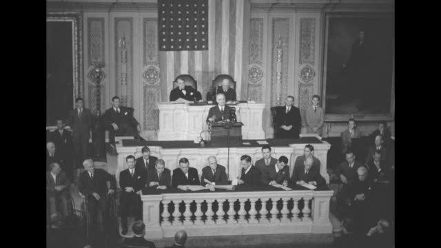 [Audio speed issues throughout] VS US President Harry Truman standing at speaker's platform in US House of Representatives chamber giving speech US...