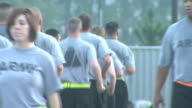 August 19 2008 TS Army soldiers jogging in formation and performing morning exercises / Fort Stewart Georgia United States
