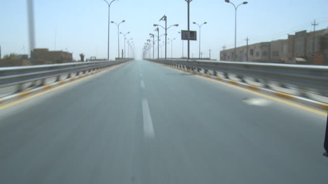 August 19 2010 REAR POV View exiting bridge and driving down wide boulevard / Fallujah Iraq