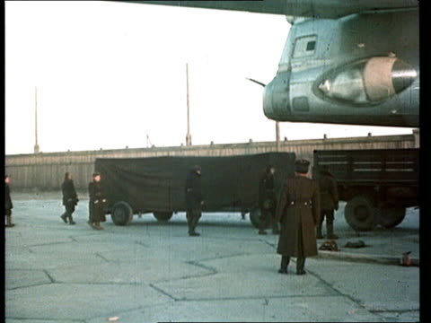 August 1949 MONTAGE WS Fallout from Soviet Union's testing of first nuclear weapon 'RDS1' at test site in Kazakhstan/ Plane on runway carrying...