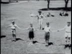 August 1951 MONTAGE Cowboy teaching children how to use bullwhip