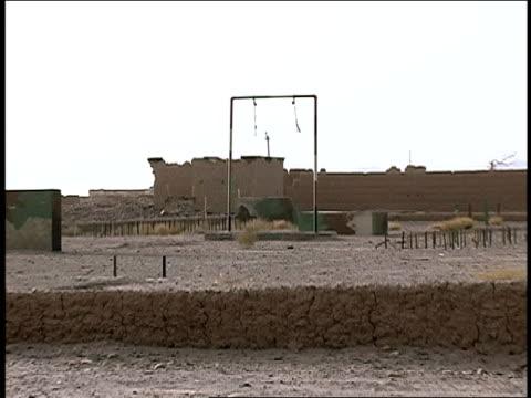 August 2004 Medium shot Barrels abandoned in deserted AlQaida military training camp/ Afghanistan