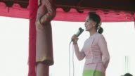 Aung San Suu Kyi addresses supporters while campaigning in Shan state ahead of next months Myanmar election