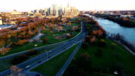 Austin Texas Aerial Drone View Lowering down at Sunset with The Downtown Skyline soaking in Sunlight