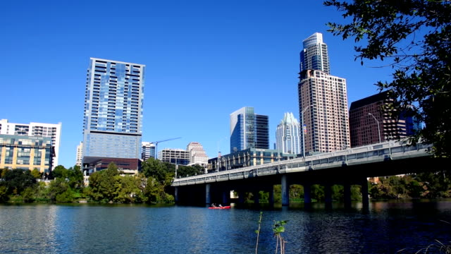 Austin Texas Skyline Clear Blue Sky Sunny Day Near Congress Bridge with Kayake passing by