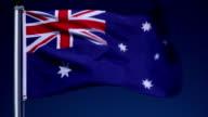 4K: Australian Flag on Flagpole in front of Blue Sky outdoors (Australia)