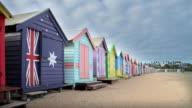 WS Australian flag painted on beach shed (beach hut) on Brighton beach / Melbourne, Victoria, Australia