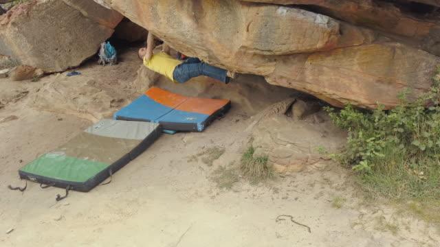 Australian Locals in Sport: A climbing man bouldering at Grampians, Victoria