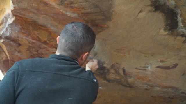 Australian Locals in Sport: A man bouldering at Grampians, Victoria