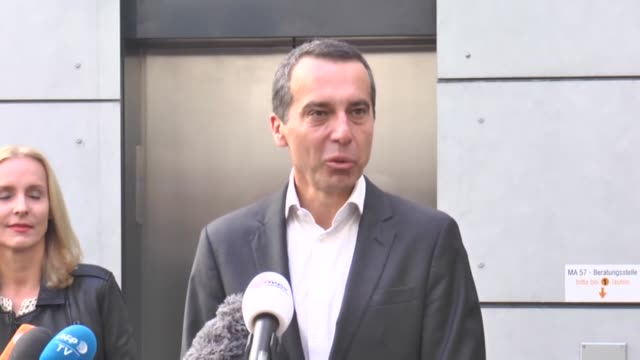 Austrian Chancellor and head of the Social Democratic Party Christian Kern speaks to the media next to his wife Eveline SteinbergerKern as they leave...