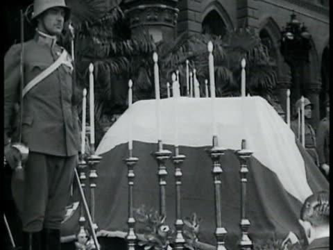 Austrian Chancellor Englebert Dollfuss w/ Fascist dictator Benito Mussolini VS Dollfuss funeral Fascist dictator Benito Mussolini on balcony...