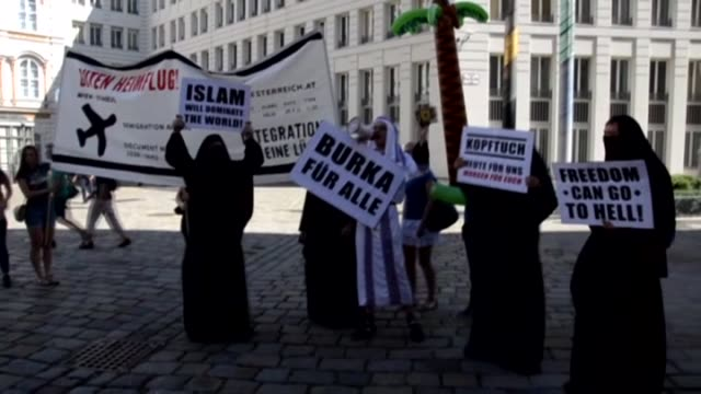 Austrian farright protesters in burqas protest with placards as activists stage a proburqa demonstration in front of the Foreign Ministry building in...