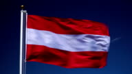 4K: Austrian Flag on Flagpole in front of Blue Sky outdoors (Austria)