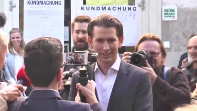 Austrian Foreign Minister and leader and candidate of the conservative Austrian People's Party Sebastian Kurz speaks to the media next to his...
