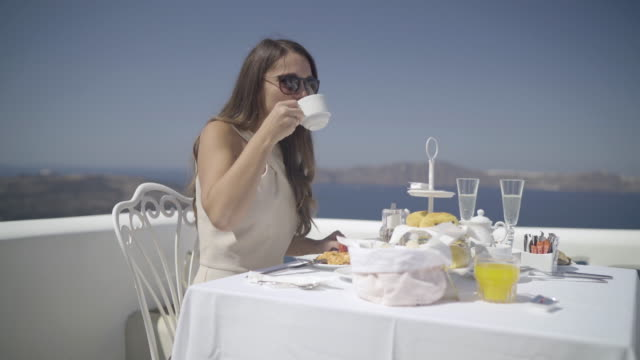 authentic wealth - woman enjoying breakfast outside