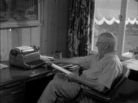 Author PGWodehouse sits at his desk at his home in New York 1958