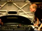 Auto mechanic repairing engine
