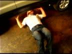 Auto mechanic under car