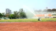 Automated sprinkler in a football stadium