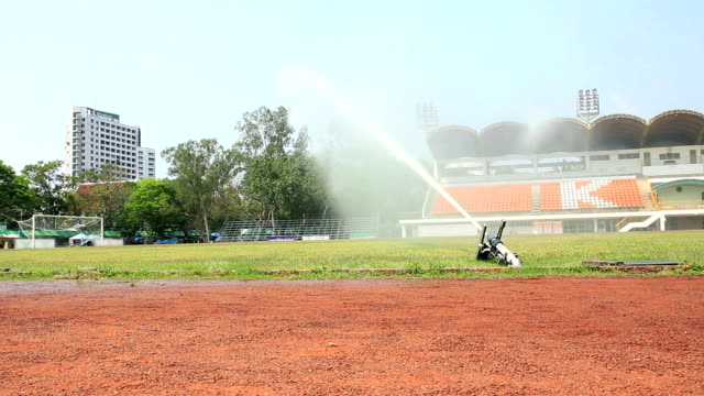 Automated sprinkler in a football stadium