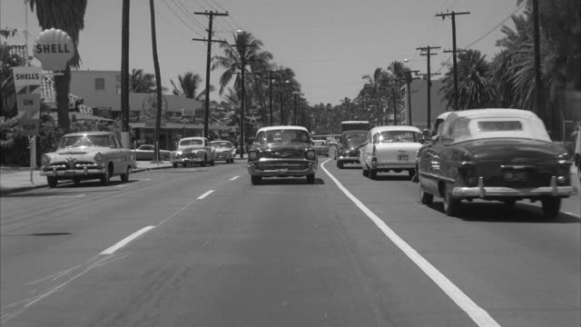 MS POV Automobile passing through poor residential area and stops at hawaiian village hotel aat honolulu hawaii