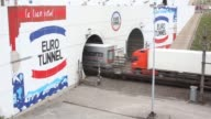 Automobiles board a Eurotunnel shuttle carriage operated by Groupe Eurotunnel SA in Calais France on Thursday July 11 A freight truck drives through...