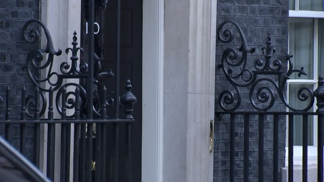 Protesters / Theresa May departure / Philip Hammond photocall Theresa May MP departing Downing Street / Philip Hammond MP and his Treasury team...