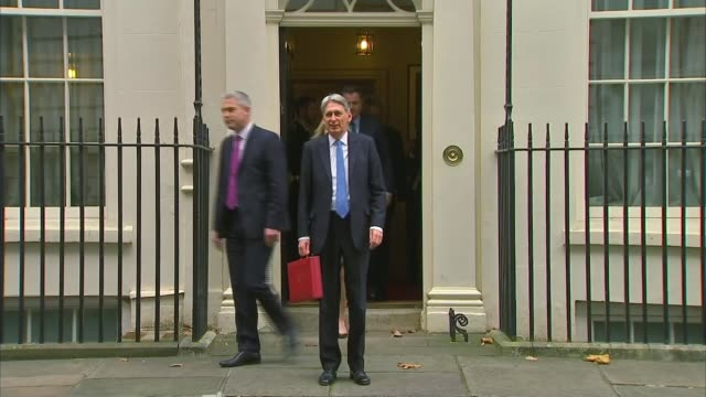 Chancellor Philip Hammond delivers Budget speech ENGLAND London Downing Street EXT Chancellor of the Exchequer Philip Hammond MP from Number 11 to...
